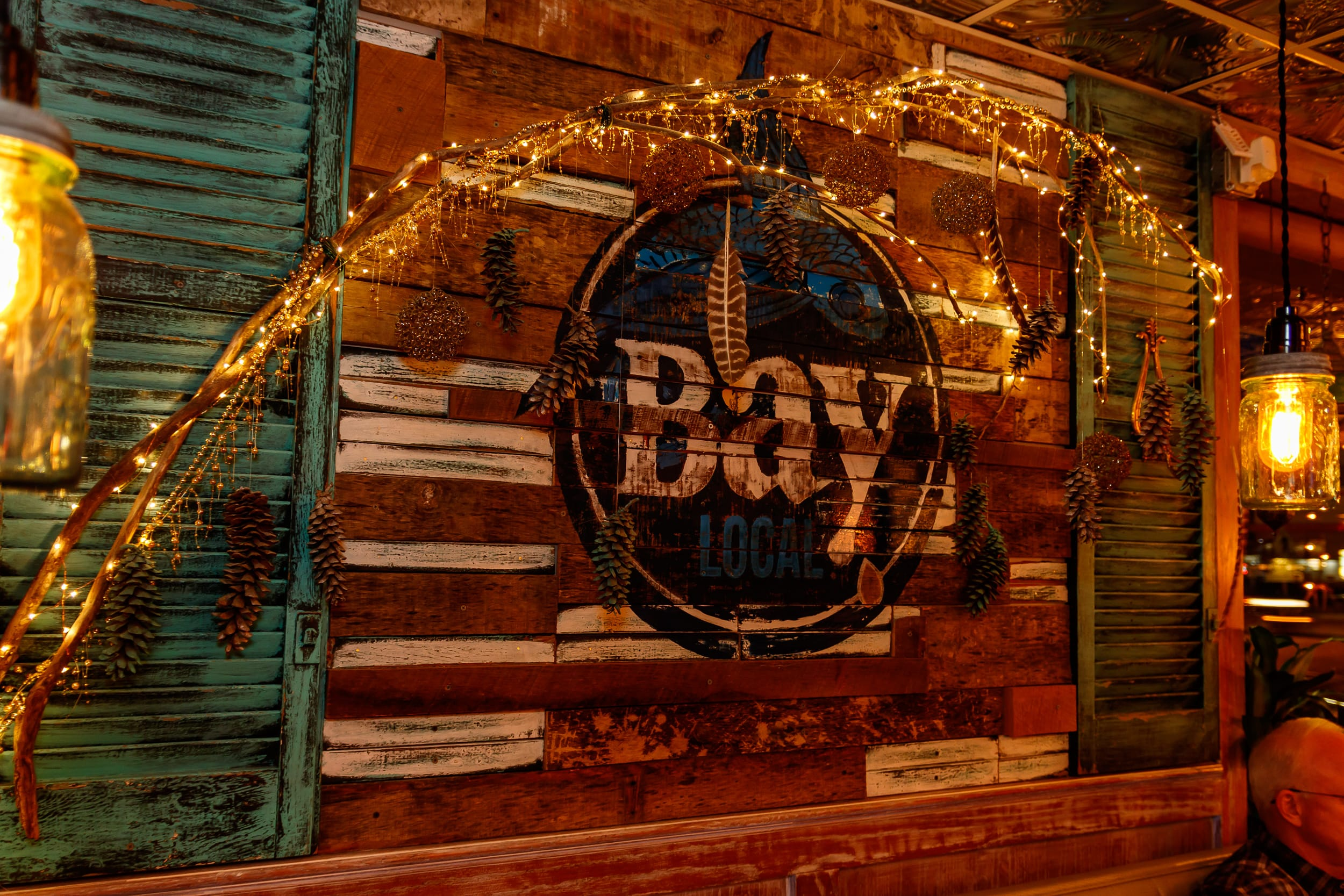 Bay Local logo on wood wall